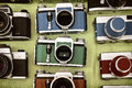 Retro styled image of photo cameras on a flee market Royalty Free Stock Photo