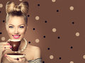 Retro styled model girl drinking coffee Royalty Free Stock Photo