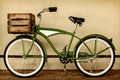 Retro styled sepia image of a vintage bicycle with wooden crate beach cruiser Royalty Free Stock Photo