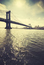 Retro stylized Manhattan Bridge against sun, NYC, USA Royalty Free Stock Photo