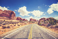 Retro stylized scenic road, Arches National Park, USA Royalty Free Stock Photo