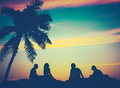 Retro sunset hawaii friends filtered image of by the beach in Royalty Free Stock Images