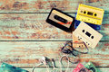 Retro tape cassette with earphone on wood table Royalty Free Stock Photo