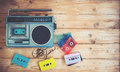 retro technology of radio cassette recorder music with retro tape cassette on wood table Royalty Free Stock Photo