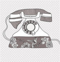 Retro telephone with flowers and birds pattern Stock Image