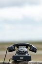 Retro telephone outdoors phone outside with copy space Royalty Free Stock Photography