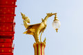 Retro thai style electrical lamp on the pillar golden color mythical female bird sculpture Royalty Free Stock Photography