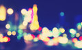Retro toned blurred street lights at night urban abstract background Stock Photography