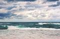 Retro toned dramatic stormy beach scene Royalty Free Stock Photo