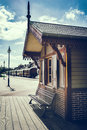 Retro touristic train station at sunny summer day Stock Images