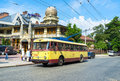The retro trolley chernivtsi ukraine june on station next to unusual building of restaurant sorbonne in city centre on Royalty Free Stock Image