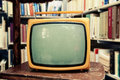Retro TV set in vintage setting - old living room Royalty Free Stock Photo