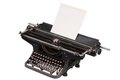 Retro typewriter with with a blank sheet of paper  isolated on white background Royalty Free Stock Photo