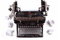 Retro typewriter with paper scattered all around Royalty Free Stock Photo