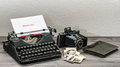 Retro typewriter and vintage photo camera on wooden table white paper page with sample text memories Royalty Free Stock Image
