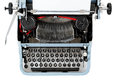 Retro uncovered blue typewriter on white background Royalty Free Stock Photos