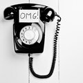 Retro versus modern telephone concept black with omg note internet slang great old fashioned communications Stock Photo