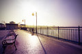 Retro vintage filtered nostalgic picture of promenade against sun Royalty Free Stock Photography
