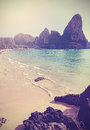 Retro vintage filtered vertical picture of a beach. Royalty Free Stock Photo