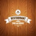 Retro vintage insignia logotype for restaurant on wood background eps Royalty Free Stock Photo