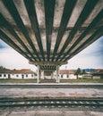 Retro vintage technology, old train tracks under the bridge, grunge background Royalty Free Stock Photo