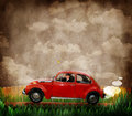 Retro volkswagen and man a in a red beetle or adjusts his glasses as he travels down a road in a vintage landscape with grass a Stock Images