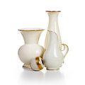 Retro white vases group of old porcelain on background Stock Photo