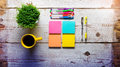 Retro white wooden table with empty colorful sticky notes Royalty Free Stock Photo