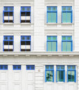 Retro windows with shutters in colonial architecture style building singapore Royalty Free Stock Photos