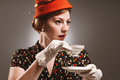 Retro woman drinking her tea a in garb a cup of Royalty Free Stock Image