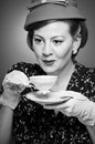 Retro woman drinking her tea a in garb a cup of Royalty Free Stock Photography