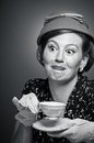 Retro woman drinking her tea a in garb a cup of Royalty Free Stock Images