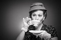 Retro woman drinking her tea a in garb a cup of Royalty Free Stock Photo