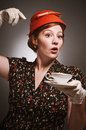 Retro woman drinking her tea a in garb a cup of Stock Photography