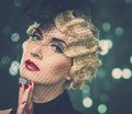 Retro woman elegant blond with red lipstick wearing little hat with veil Royalty Free Stock Photos