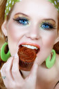 Retro woman in green and chocolate cupcake Royalty Free Stock Images