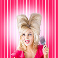 Retro woman with hairstyle love heart shape hair comic portrait of a pinup holding styling comb while looking up a shaped style Royalty Free Stock Image