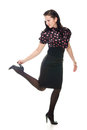 Retro woman lifted her leg holds heel white background Stock Photo