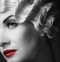 Retro woman monochrome portrait of elegant blond with beautiful hairdo and red lipstick Royalty Free Stock Images
