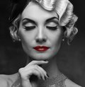 Retro woman monochrome portrait of elegant blond with beautiful hairdo and red lipstick Royalty Free Stock Photos