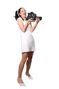 Retro woman with an old camera in white dress film laughing isolated on white background Royalty Free Stock Photography