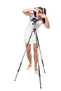Retro woman with an old camera in white dress on a tripod creates a frame her hands isolated on white background Royalty Free Stock Photo