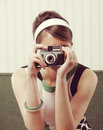 Retro woman with old fashioned camera young photographing vintage film Royalty Free Stock Photography