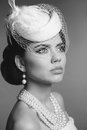 Retro woman portrait. Elegant lady with hairstyle, pearls jewelr