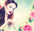 Retro woman portrait in pink roses garden Royalty Free Stock Photo