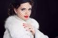 Retro woman posing in luxury fur coat. Fashion model girl portra Royalty Free Stock Photo