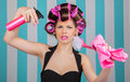 Retro woman in rollers multitasking Royalty Free Stock Photo