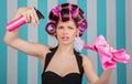 Retro woman in rollers multitasking
