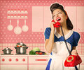 Retro woman talking on phone in her kitchen interior poster Royalty Free Stock Photo