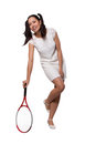 Retro woman with a tennis racket in white dress relies on isolated on white background Stock Photo